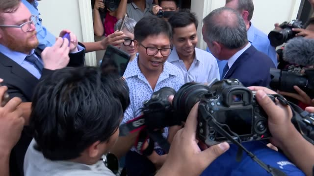 reuters journalists wa lone and kyaw soe oo surrounded by press in yangon after having been released from prison jailed for their reporting on the... - prisoner released stock videos & royalty-free footage