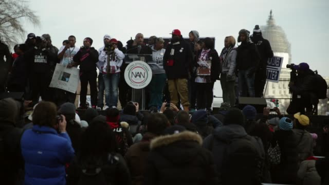 rev al sharpton president of national action network is joined by family members of police shooting victims on stage during the postmarch rally... - al sharpton stock videos & royalty-free footage