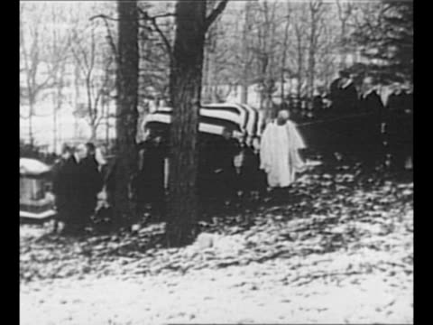 ws rev george e talmadge walks down snowcovered hill at youngs memorial cemetery to meet pallbearers who carry flagdraped casket of former us... - theodore roosevelt us president stock videos & royalty-free footage