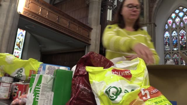 rev. richard dimery, vicar of pudsey parish church, talks about the deliveries they are making to parishioners in need during this half term as part... - プラスキー点の映像素材/bロール