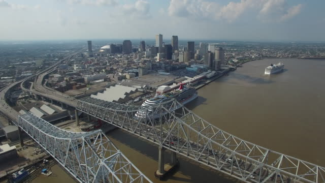 reveal new orleans city over bridge- Drone Aerial 4K Mississippi river bridge and barge 1of14, everglades, gulf delta, new orleans, st louis, with cruise boats sailing and wildlife 4K Transportation