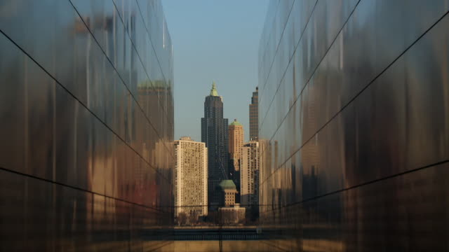 reveal of the 9/11 memorial wall at liberty state park.   - september 11 2001 attacks stock videos and b-roll footage