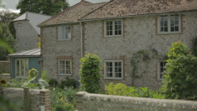 reveal of traditional flint cottage in sussex - lime stock videos and b-roll footage