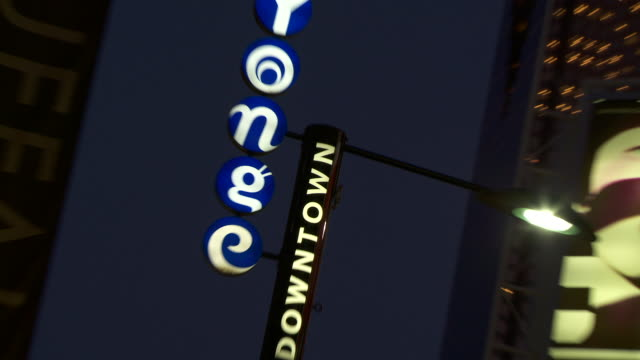 Reveal to the Yonge St Downtown street sign.  Yonge St is famous for being Canada's longest street as well as for its famous shopping district.