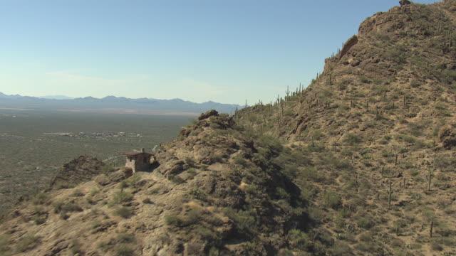 WS AERIAL Reveal valley over saguaro ridge and Tucson Mountains / Tucson, Arizona, United States