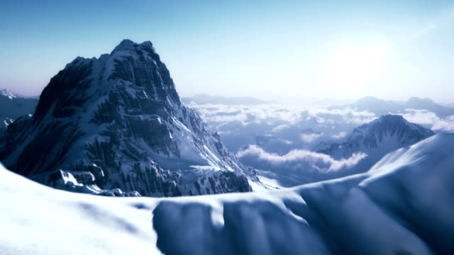 revealing a mountain peak - snowcapped mountain stock videos and b-roll footage