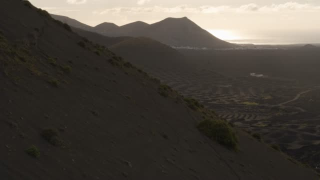 revealing aerial shot of mountains in lanzarote - mountain stock videos & royalty-free footage
