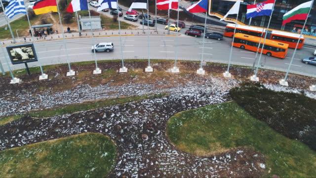 vídeos de stock e filmes b-roll de revealing drone shot aerial view of european union flags in sofia, bulgaria - eastern european culture