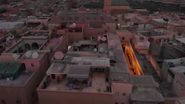 Revealing drone shot of a Moroccan town