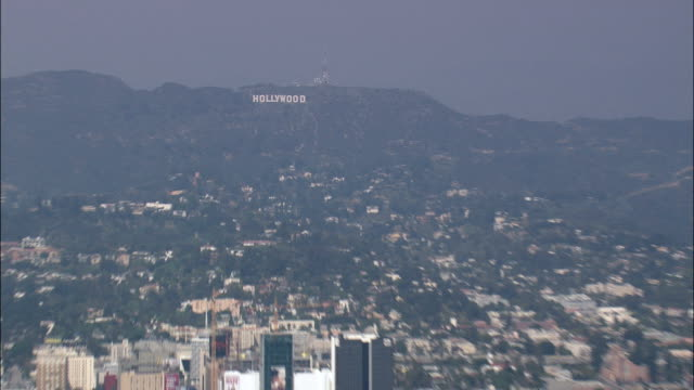 revealing hollywood from the hill top sign  - aerial view - california,  los angeles county,  united states - hollywood sign stock videos & royalty-free footage