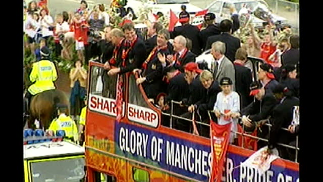 reveals name of footballer at centre of super injunction speculation; 1999 manchester: 1999 ext treble winning manchester united team along on open... - parade stock videos & royalty-free footage