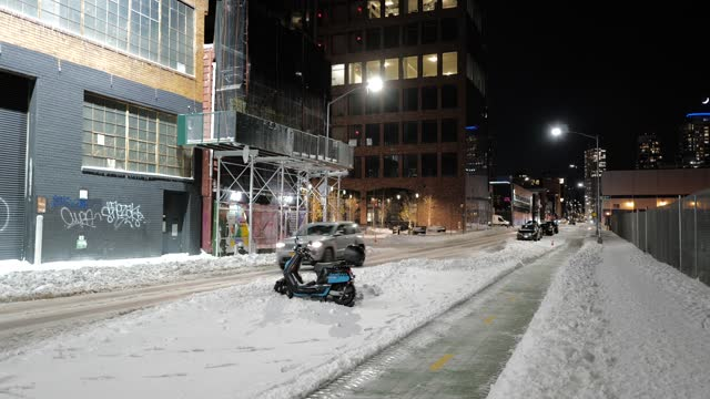 revel electric moped stands stuck in the snow in williamsburg, brooklyn on december 17 in new york city. a nor'easter brought heavy snowfall to new... - pet owner stock videos & royalty-free footage
