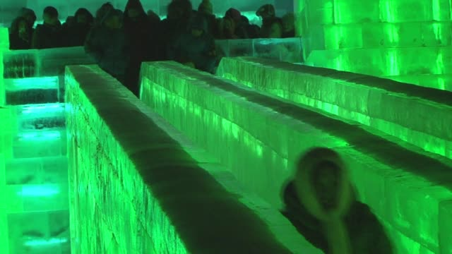 vídeos y material grabado en eventos de stock de revelers brave temperatures well below freezing to see ice sculptures and slide down chutes at one of the worlds biggest ice and snow festivals - producto de arte y artesanía