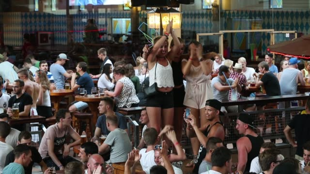revelers celebrate at the bierkoenig beer hall near the ballermann stretch on july 27, 2017 in palma de mallorca, spain. the term ballermann, which... - majorca stock videos & royalty-free footage