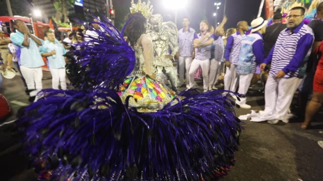 revelers celebrate before parading outside the sambodrome on february 28 2017 in rio de janeiro brazil - street party stock videos & royalty-free footage