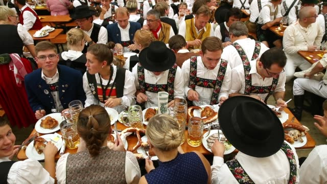 revelers celebrate in the schottemhamel tent on the opening day of the 2018 oktoberfest beer festival on september 22 2018 in munich germany this... - traditional clothing stock videos & royalty-free footage