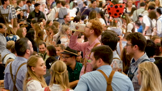 revelers celebrate in the traditional tent on the opening day of the 2019 oktoberfest on september 21, 2019 in munich, germany. this year's... - tradition stock videos & royalty-free footage