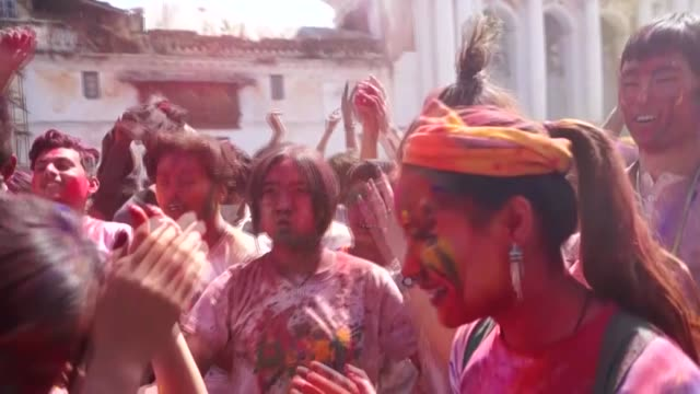 Revelers covered in colors celebrate 'Holi' or festival of colors in Kathmandu Nepal on March 12 2017 Holi is a Hindu spring festival celebrates in...