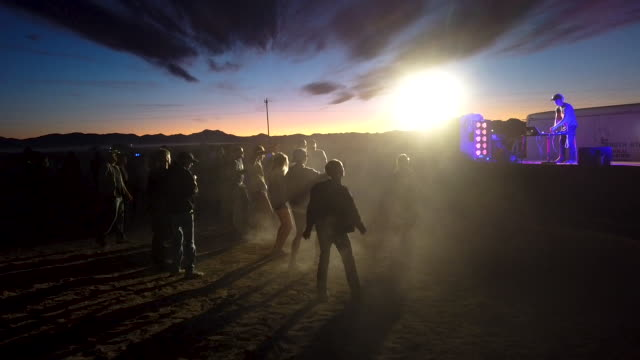 revelers dance at the 'storm area 51' spinoff event 'alienstock' on september 20, 2019 in rachel, nevada. the event is a spinoff from the original... - nevada stock-videos und b-roll-filmmaterial