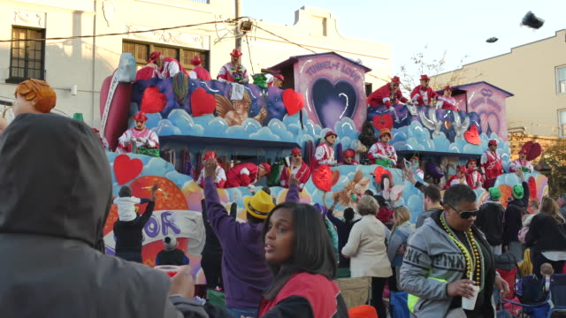 Revelers extend their hands for beads as the Thoth parade float passes on St Charles Street during Mardi Gras in New Orleans The Theme of the Thoth...