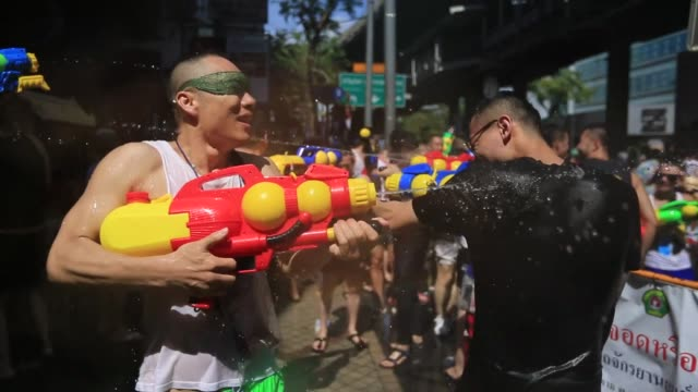 revelers take part in a water fight as they celebrate the first day of the thai traditional new year, known as songkran festival, in the business... - water fight stock videos & royalty-free footage