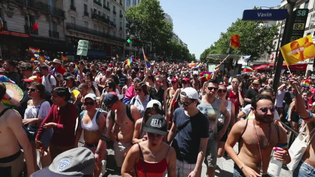 reveler's takes part in the paris gay pride march in sweltering temperatures of 36 degrees which this year commemorates the 50th anniversary of the... - two generation family stock videos & royalty-free footage