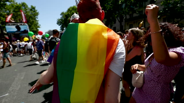reveler's takes part in the paris gay pride march in sweltering temperatures of 36 degrees which this year commemorates the 50th anniversary of the... - one parent stock videos & royalty-free footage