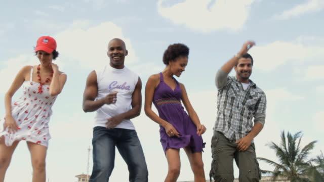ms zo slo mo reveling dancers dancing salsa on cement hedge / havana, cuba - salsa stock videos & royalty-free footage