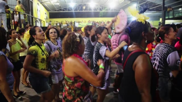 revellers dance at the gres sao clemente samba school's carnival rehearsal on february 10 2015 in rio de janeiro brazil - samba school stock videos and b-roll footage