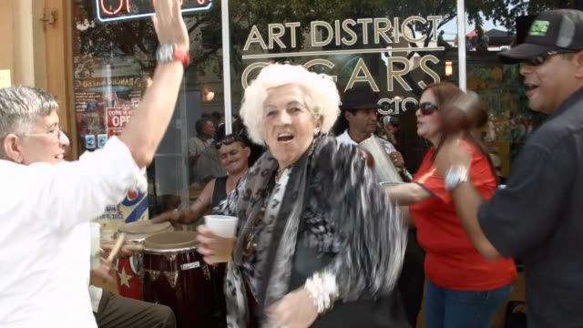 MS Revellers dance sing and celebrate the Calle Ocho festival General clips of the Calle Ocho street festival in the Little Havana neighbourhood of...