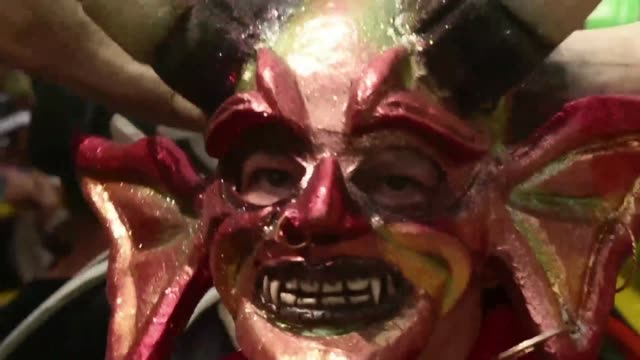 revellers in western colombia disguised as devils participate in the cuadrillas parade during riosucio's devil's carnival - carnival stock videos and b-roll footage