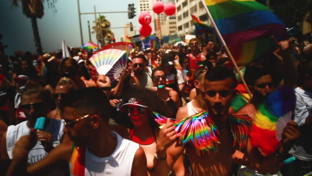 revellers take part in the annual gay pride parade on june 14 2019 in tel aviv israel tens of thousands of israelis and tourists packed the streets... - pride stock videos & royalty-free footage