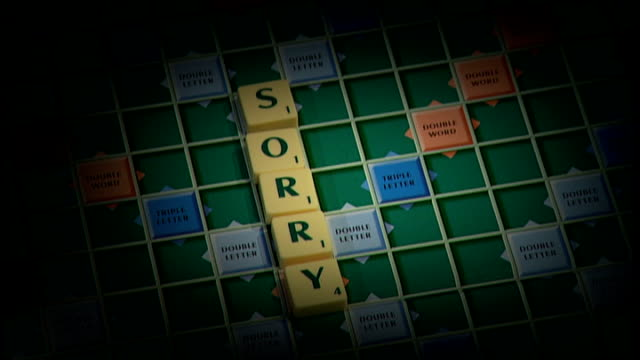 hm revenue and customs tax miscalculations dave hartnett apologises england london scrabble board with letters appearing - 登場点の映像素材/bロール