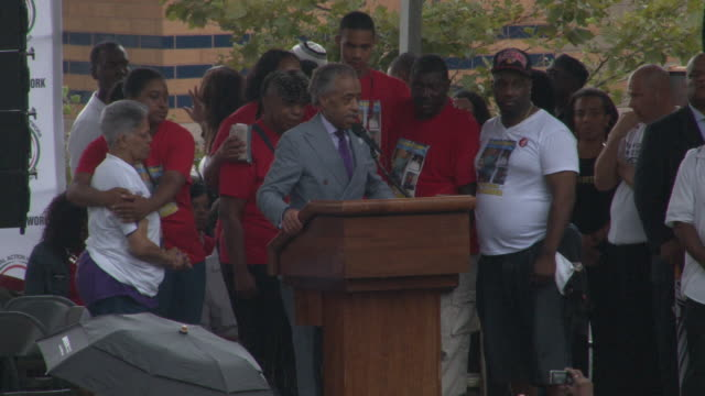 reverend al sharpton concludes his speech at the we will not go back march for justice rally to protest the death of eric garner at police hands /... - al sharpton stock videos & royalty-free footage