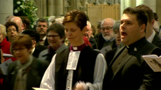 reverend libby lane consecrated as first female church of england bishop; england: north yorkshire: york: york minster: int high angle shots of... - religious service stock videos & royalty-free footage