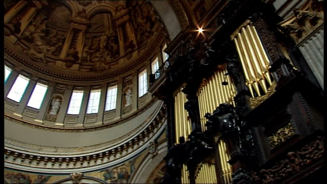 Reverend Lucy Winkett conducts St Paul's service Organ and domed roof/ ornate decorations and paintings on ceiling/ general views of altar
