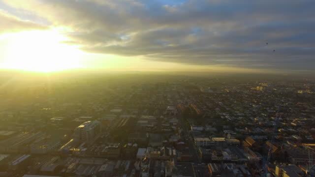 a reverse aerial establishing shot of the melbourne urban sprawl. - david ewing stock videos & royalty-free footage