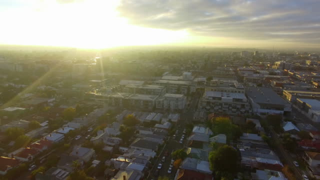 A reverse aerial establishing shot of the Melbourne urban sprawl.