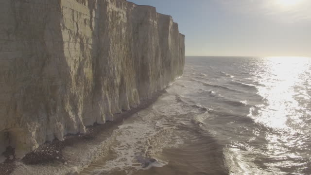 reverse aerial track along chalk cliffs in nice light - english channel stock videos and b-roll footage
