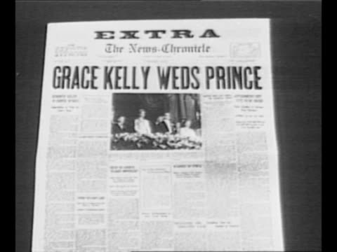 reverse angle typesetting frame as vo typewriter sounds letters appear individually to form mirror image of words greatest headlines on one row and... - grace kelly actress stock videos and b-roll footage