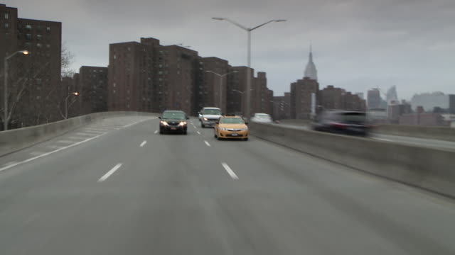 Reverse POV driving footage of the FDR highway driving south