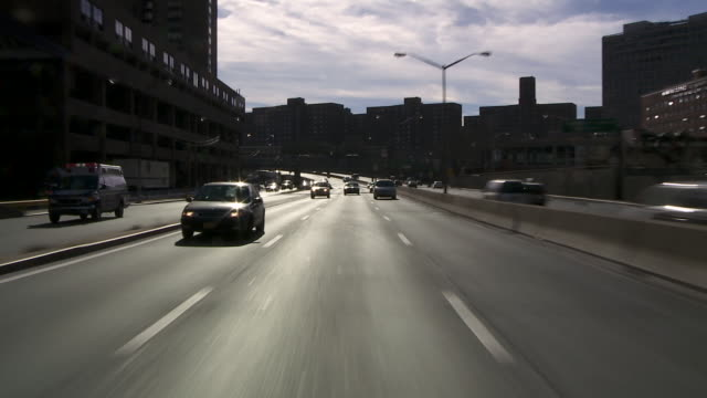 Reverse POV driving North bound on the FDR Highway in Manhattan.