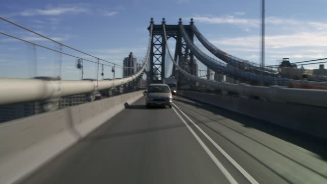 Reverse POV driving over the Manhattan Bridge in New York City