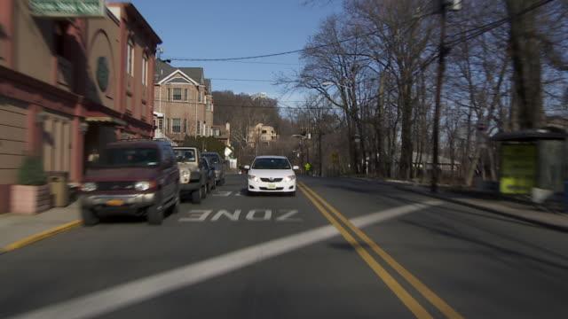 Reverse POV Driving through a suburban neighborhood