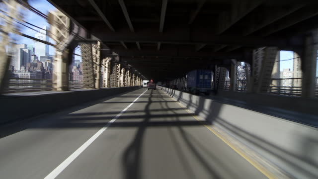 Reverse POV driving underneath the Queensboro bridgefrom New york city to Brooklyn.