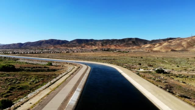 reverse pan over california aqueduct, palmdale ca - aqueduct stock videos and b-roll footage