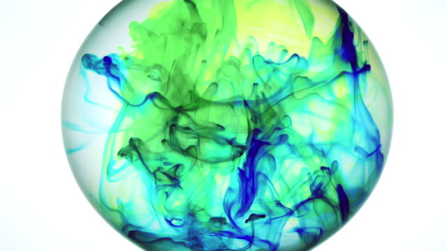 reverse playback of green colored water becoming flowing ink in blue, green and yellow in a rotating sphere - sphere stock videos & royalty-free footage