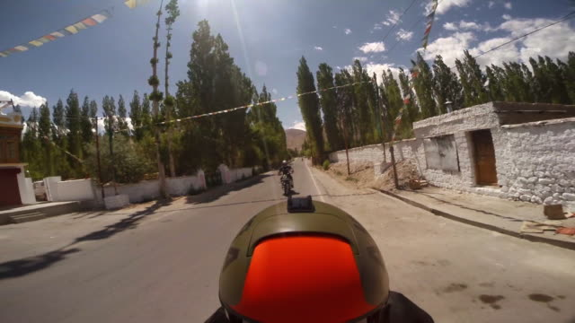 reverse shot of motorcycle journey, india - direction stock videos & royalty-free footage