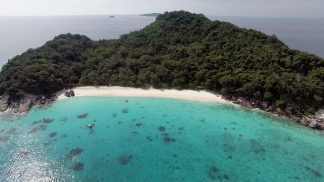 Reverse shot revealing a remote deserted beach, Similan Islands, Thailand