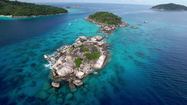 reverse shot revealing the pristine waters of the similan islands, thailand - david ewing stock videos & royalty-free footage